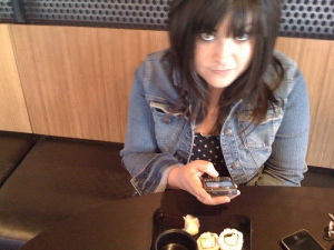 Notice the iphone and blackberry, new bangs and sushi!